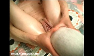 Gina jams a massive object in her moist snatch