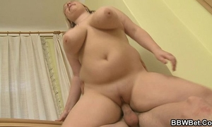 Busty plumper enjoys riding and engulfing his large dong